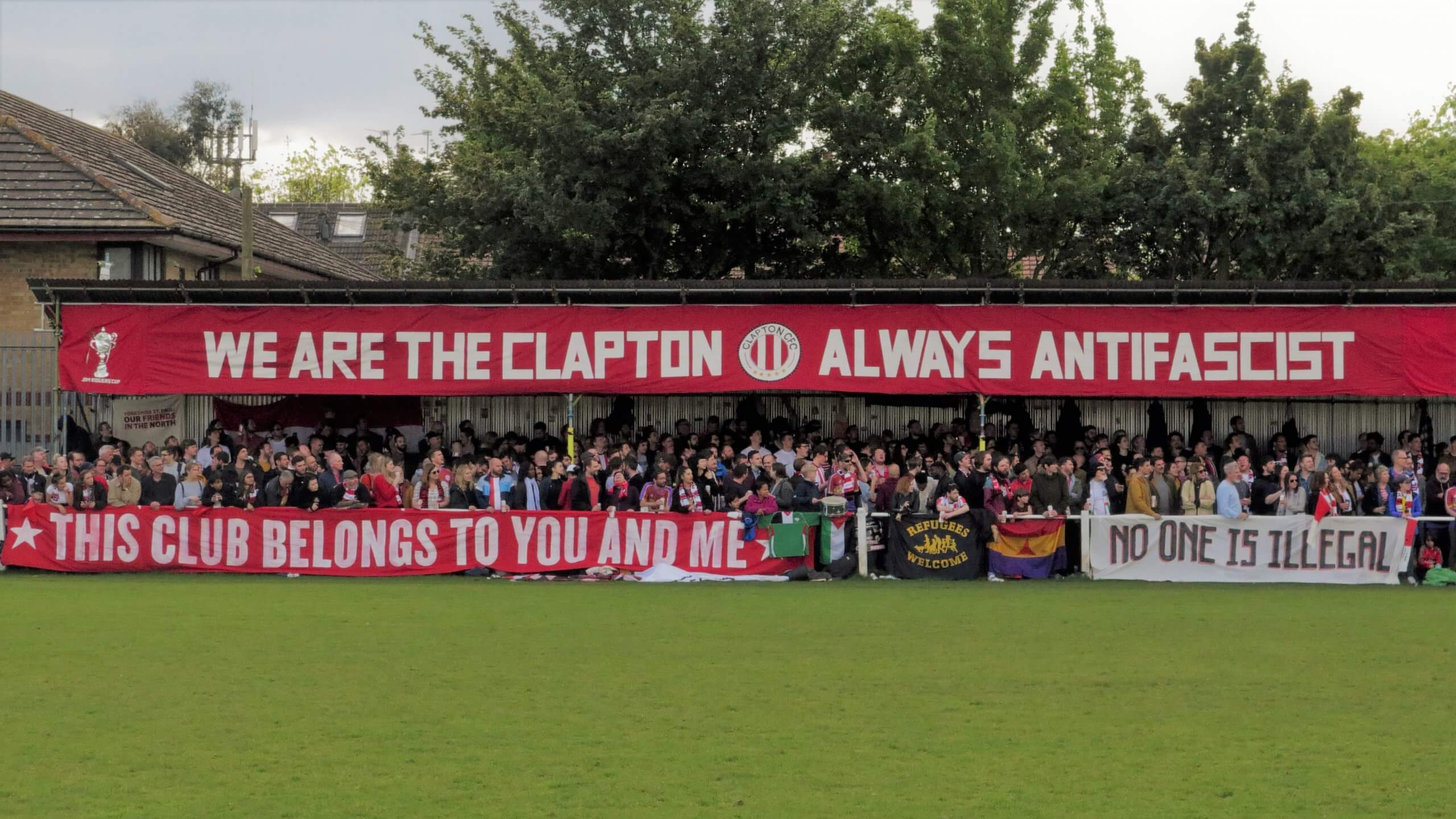 Stadium full of Clapton FC fans with anti-fascist banner